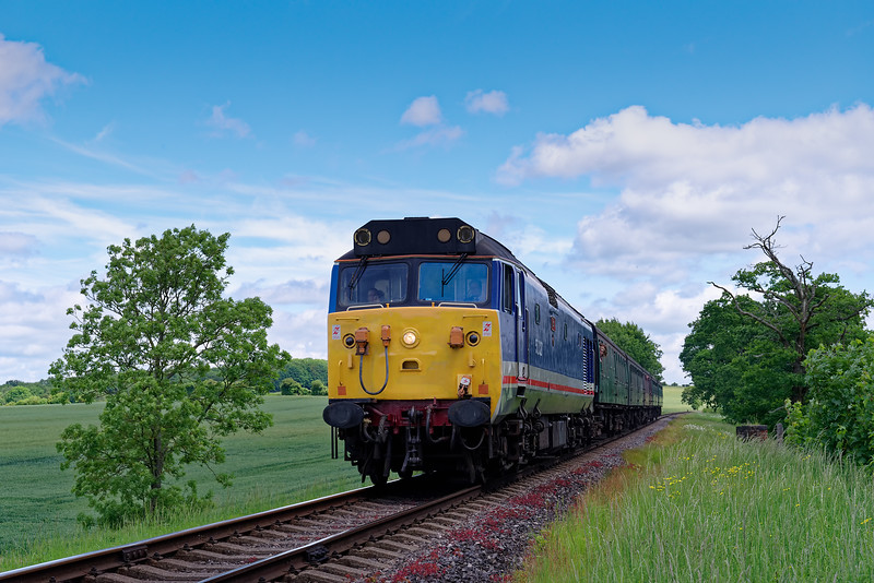 50027 crosses Rookwood Lane Bridge, with the 12:00 Alton - Alresford, <br /> during the Diesel Gala on 2nd June 2018.