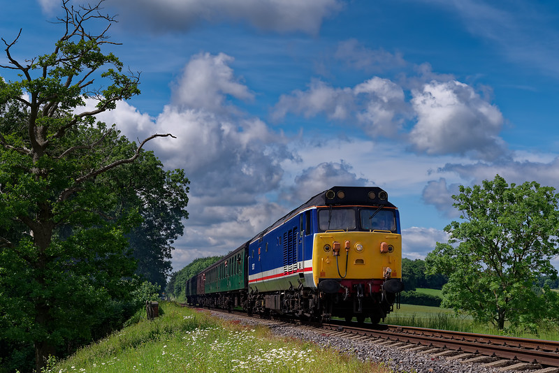 50027 crosses Rookwood Lane Bridge, with the 10:55 Alresford - Alton, <br /> during the Diesel Gala on 2nd June 2018.