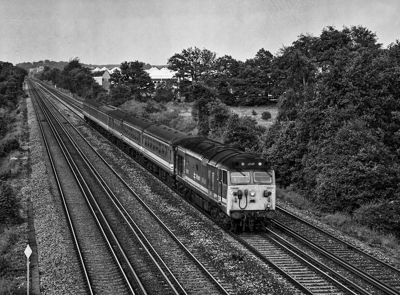 50027 at Summit Avenue, Fleet, with the 18:15 Waterloo - Salisbury, on 9th June 1990. Scanned Negative.