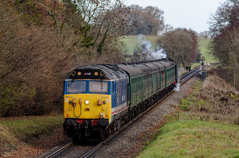 50027 passes the Ropley Down Distant signal, with the 11:25 Medstead & Four Marks - Alresford Santa Special, on 14th December 2013. U-class 31806 is on the rear.