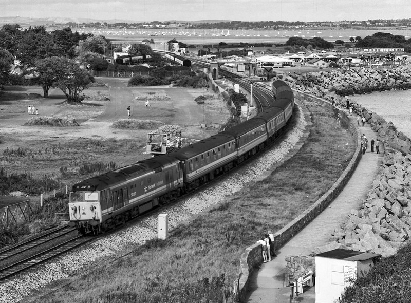 50027, viewed from Langstone Rock, Dawlish Warren, with the 12:05 Paddington - Penzance, on 3rd September 1988. Scanned Negative.