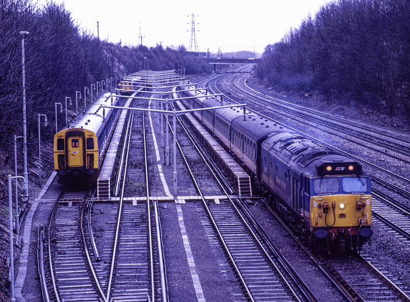 Due to low loco availability on 2nd January 1991, Waterloo - Exeter services were only running between Basingstoke and Exeter St Davids. 50027 is shown here, in Barton Mill sidings, waiting to form the 15:02 Basingstoke- Salisbury service. Scanned Transparency.