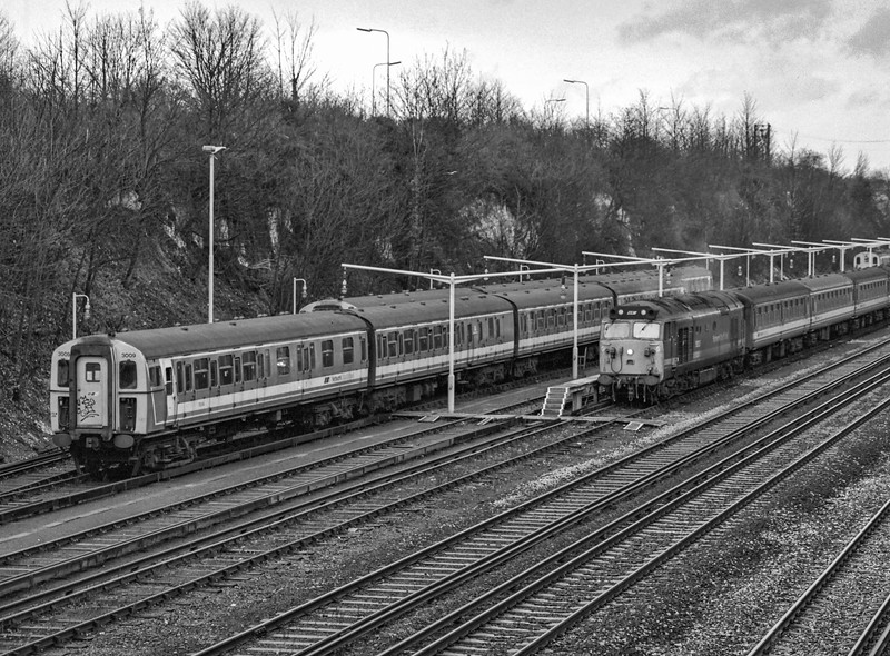 Due to low loco availability on 2nd January 1991, Waterloo - Exeter services were only running between Basingstoke and Exeter St Davids. 50027 is shown here, in Barton Mill sidings, waiting to form the 15:02 Basingstoke- Salisbury service. Scanned Negative.