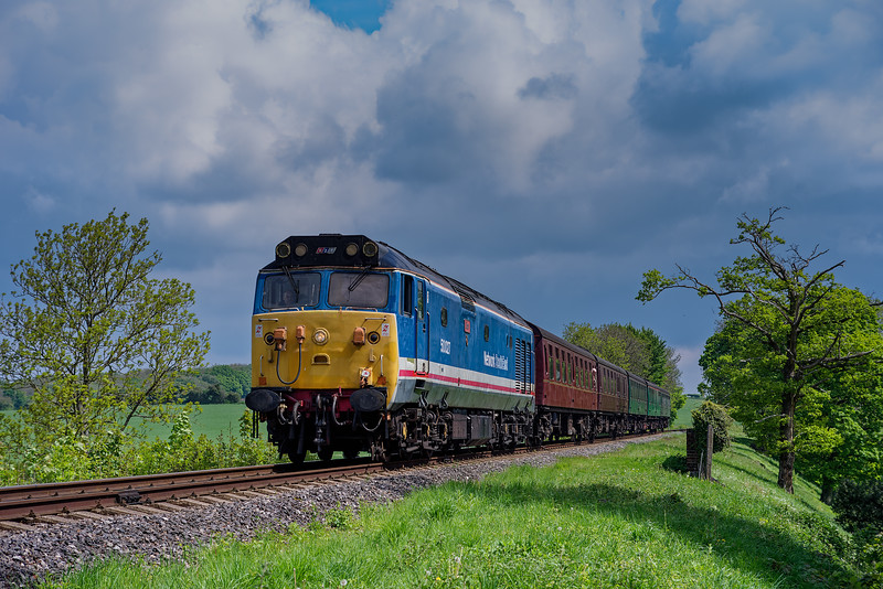 50027 crosses Rookwood Lane Bridge, with the 11:20 Alton - Alresford, on 15th May 2016.