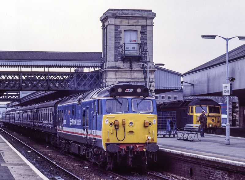 50027 at Exeter St Davids, with the 10:25 Paignton - Paddington relief, on 8th April 1988. 47528 is waiting in platform 6 with the 11:32 relief to Leeds. Scanned Transparency.