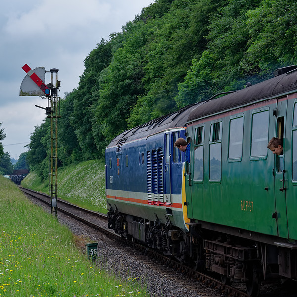 The Ropley Down Outer Home signal clears for 50027 to proceed, <br /> with the 14:00 Alton - Alresford, during the Diesel Gala on 1st June 2018.