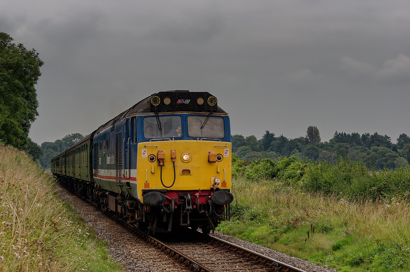 50027 approaches Wanders Crossing, with the 13:00 Alton - Alresford, <br /> during the Diesel Gala on 5th September 2014.