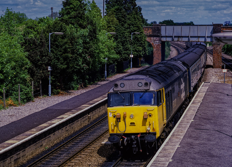 50027 powers through Aldermaston with 1C44. the 13:45 Paddington - Penzance, <br /> on 2nd June 1984. Scanned Transparency.