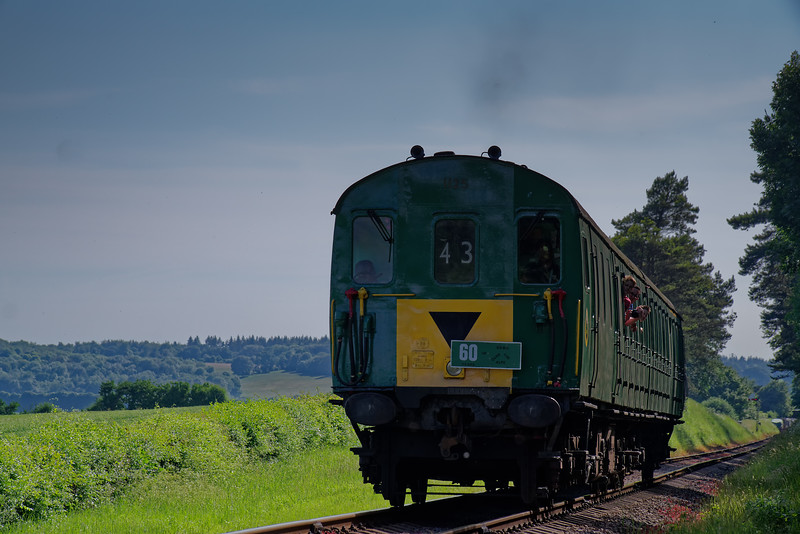 1125 exits the pine trees, with the 16:15 Alresford - Alton, <br /> during the Diesel Gala on 2nd June 2018.
