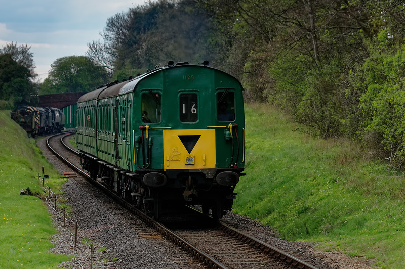 1125 at College Crossing with the 15:55 Alresford - Alton, <br /> during the Diesel Gala on 23rd April 2016.