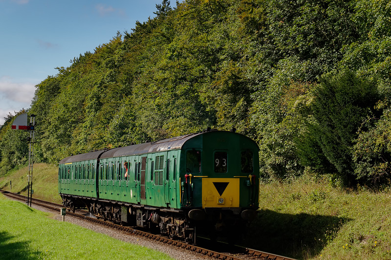 1125 passing Ropley Down Outer Home signal, with the 11:05 Alresford - Alton <br /> on 19th September 2015.