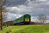 1125 crossing Rookwood Lane Bridge, with the 11:55 Alresford - Alton, <br /> during the Diesel Gala on 23rd April 2016.