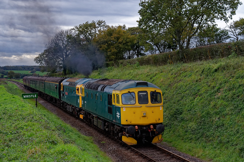 33053 and 33202 pass the whistle board for Wanders Crossing, <br /> with the 13:45 Alresford - Alton, during the Diesel Gala on 22nd October 2017.