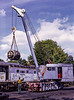 33204 and the Steam Crane in the yard at Ropley, during the transfer of the Main Generator from 204 t0 208, on 29th August 1998.  Scanned Transparency.