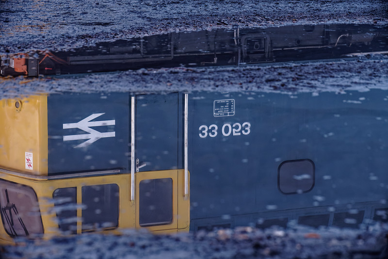 33053 reflected in a puddle in Ropley Yard, on 31st December 2016.