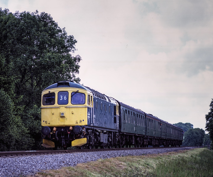 33053 at Stable Lane, with the 10:30 Alton - Alresford, during the Diesel Gala <br /> on 29th May 2009. Scanned Transparency.