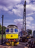 33208 and the Steam Crane in the yard at Ropley, during the transfer of the Main Generator from 204 t0 208, on 29th August 1998.  Scanned Transparency.