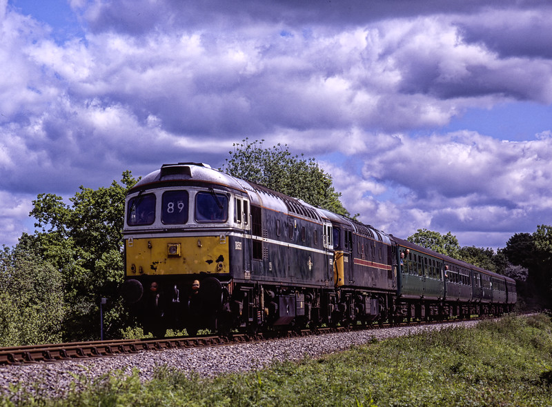 33208 and 33108 at Bluebell Crossing, with the 11:06 Alton - Alresford, <br /> during the Diesel Gala on 22nd May 2004.  Scanned Transparency.