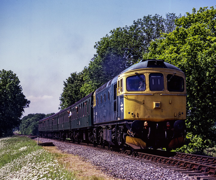 33053 at Rookwood Lane, with the 11:20 Alresford - Alton, during the Diesel Gala <br /> on 31st May 2009. Scanned Transparency.