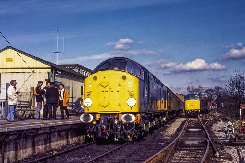 40012 waits to depart from Alton, with the 13:44 service to Alresford, while 45132 stands ready to take out the next departure. During the Diesel Gala on 4th March 1995. <br /> Scanned Transparency.