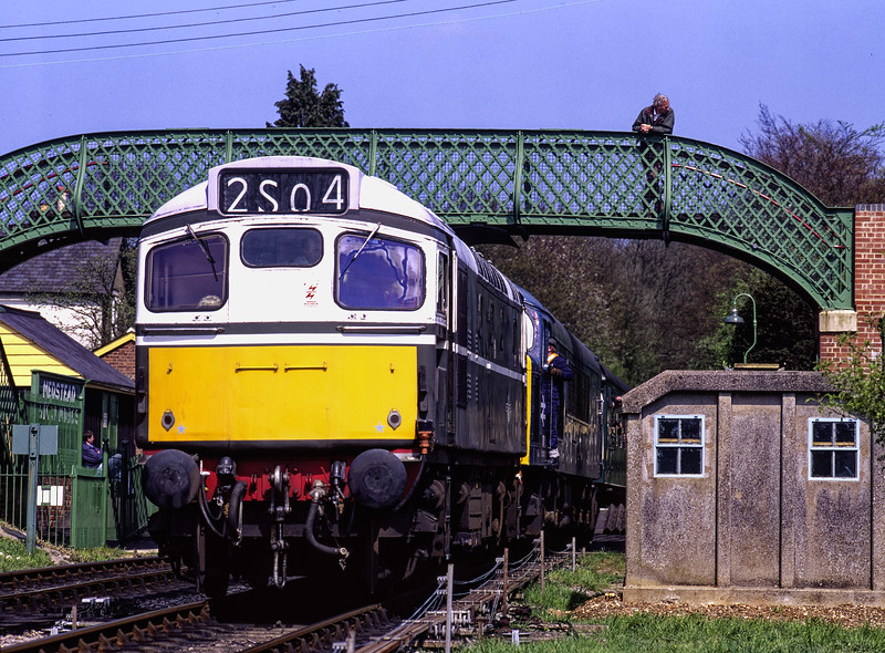 """On 2nd May 1998, 45132 suffered a rare failure at Medstead & Four Marks, while working the 13:52 Alton - Alresford. 27007 was dispatched from Ropley to provide assistance. <br /> The """"Peak"""" was back in traffic the next day, so the problem must have been fairly minor. <br /> The 27 shown here coupled up to the 45 and ready to depart. Scanned Transparency."""