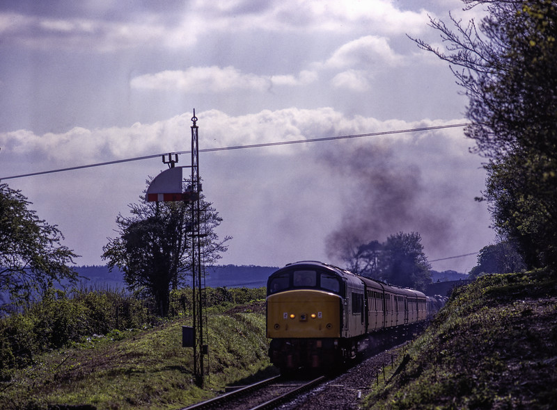 45132 passes the Ropley Down Home signal, with the 15:32 Alresford - Alton, <br /> on 3rd May 1998. Scanned Transparency.