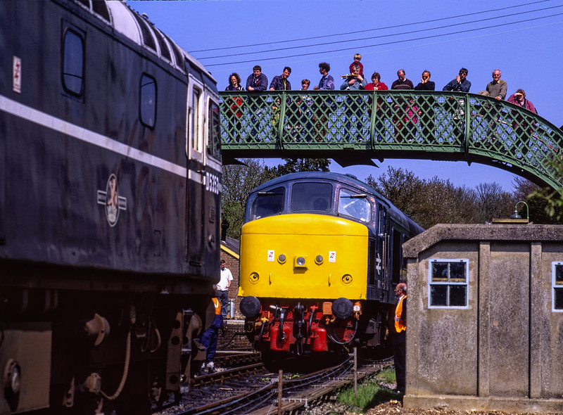"""On 2nd May 1998, 45132 suffered a rare failure at Medstead & Four Marks, while working the 13:52 Alton - Alresford. 27007 was dispatched from Ropley to provide assistance. <br /> The """"Peak"""" was back in traffic the next day, so the problem must have been fairly minor. <br /> The 27 shown here preparing to couple up to the 45. Scanned Transparency."""