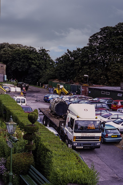 The Main Generator from 45132, safely loaded on the flatbed, departs from Ropley, <br /> on 29th July 2008. Scanned Transparency.
