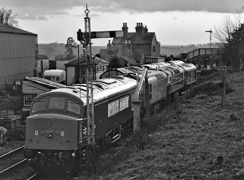 45132, 33116, 27007, 25067, 37892, 47004 and D7018 stabled overnight at Ropley, <br /> during the Diesel Gala on 5th March 1994. Scanned Negative.