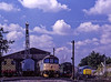 12049, Steam Crane, 33204, 33208 and 73096 at Ropley as 45132 departs with the 11:30 Alresford - Alton, on 29th August 1998. Scanned Transparency.