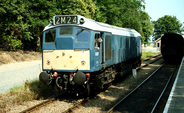 25057 running round its stock at Holt. 29.06.03