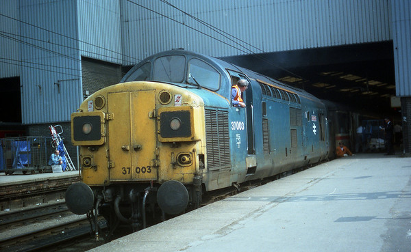 37003 getting ripped off the front of 1V54 1141 York - Swansea. 01.08.91