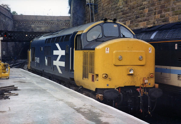 37408 at Glasgow Queen Street backing onto 1L31 1603 to Perth. 26.11.88