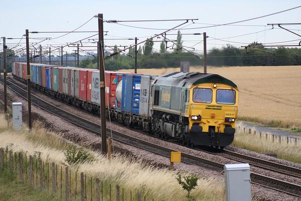 66517 thunders past Colton on 4L79 1606 Wilton - Felixstowe liner. 21.07.05