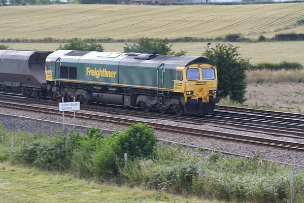 66513 passes Colton South Junction on 4S07 1500 Ferrybridge PS - Hunterston coal service. 19.07.05