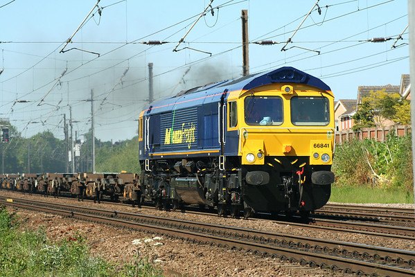 66841 storms past the former Dringhouses Yard near York on 4Z70 1600 York Yard South - March container flats. 01.06.09