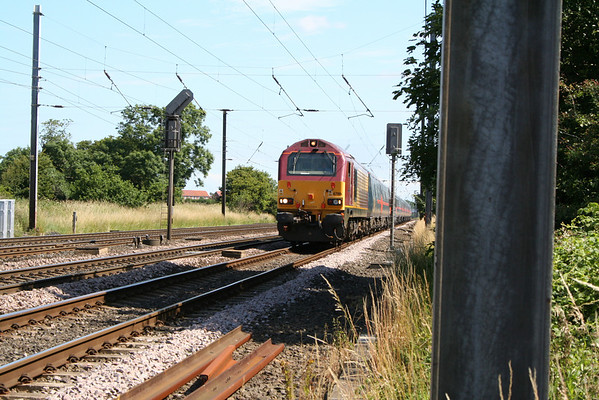 67001 storms past Copmanthorpe on an ECS mk4 set from Craigentinny to Bounds Green. 11.07.05