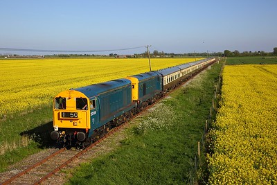 20189+20205 on the 1Z24 Dungeness to London Victoria approaching Swamp crossing west of Lydd on the 5th May 2018