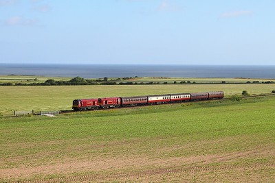 20142+20227 on the 0830 Sheringham to Holt approaching Weybourne on the 9th June 2017