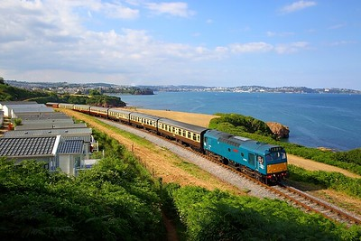 25185 D7535 on the 1715 Paignton to Kingswear at Waterside caravan park on the 15th July 2018