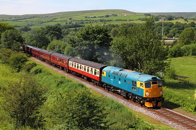 26038 on the 2J55 1015 Heywood to Rawtenstall at Irwell Vale on the 3rd July 2015
