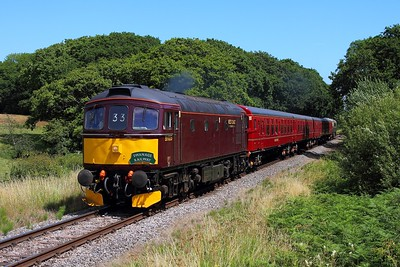 33025 tnt 33012 on the 2Z14 1423 Swanage to Wareham at Quarr Farm on the 9th July 2017