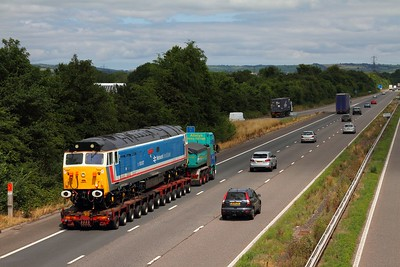 50017 on a low loader on the M5 at Tiverton on the 15th July 2014 - going from Plym Valley to Washwood Heath