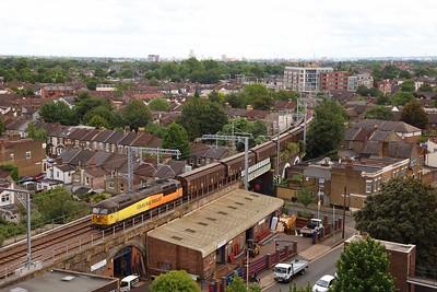56087 on the 6Z30 1535 Dagenham to Bridgend at Wanstead Park on the 19th June 2019