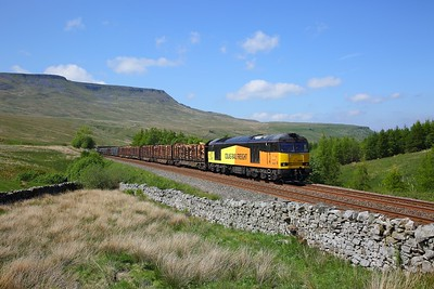 60021 on the 6J37 Carlisle yard to Chirk loaded timber about to crest the summit at Ais Gill on the 28th May 2018