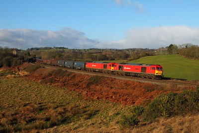 0062 leads 60044 on the 6H25 Margam to Llanwern at St Georges east of Miskin on the 27th December 2014 hires