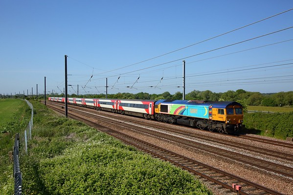 GBRf rainbow 66720 works the 5Z91 0811 Bounds Green to Doncaster Down Decoy at Great Paxton near Huntingdon on 25 May 2020