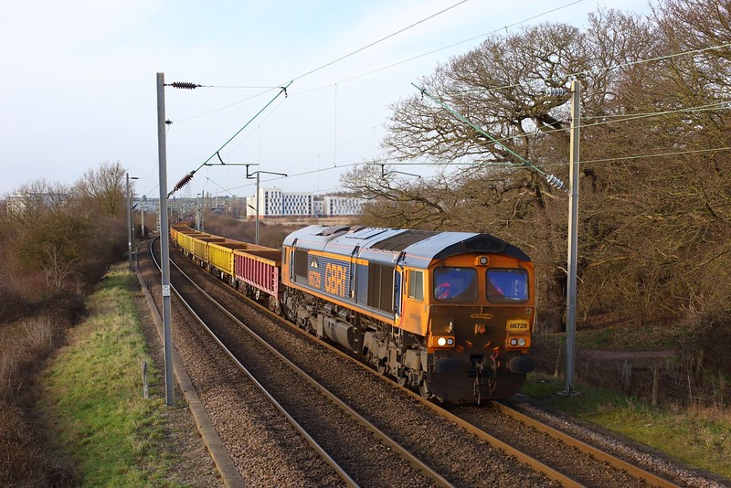 66729 leads 66782 working 6T63 1058 Whitemoor yard to Thorpe-le-Soken passes University of Essex, Hythe on 20 February 2021  GBRf66, ClactonLine
