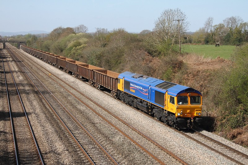 66718 powers the 6Z33 Cardiff Tidal to Hexthorpe empty box wagons at Llandevenny on the 1st April 2012  GBRF66, Metronet, SouthWalesmainline