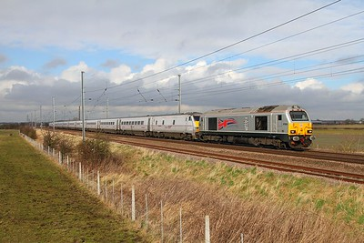 67026 leading 82226 tnt 91107 on the 5E02 0919 Newcastle to Bounds Green at Claypole on the 18th Feb 2014  1E02 0548 ex Edinburgh failed at Newc power issues with DVT